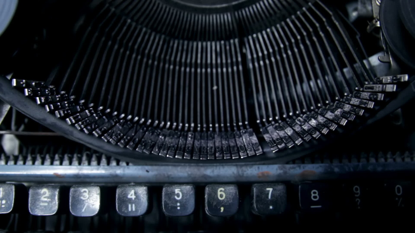 Close up of keystrokes typing on vintage typewriter   Shutterstock HD Video #1044999814