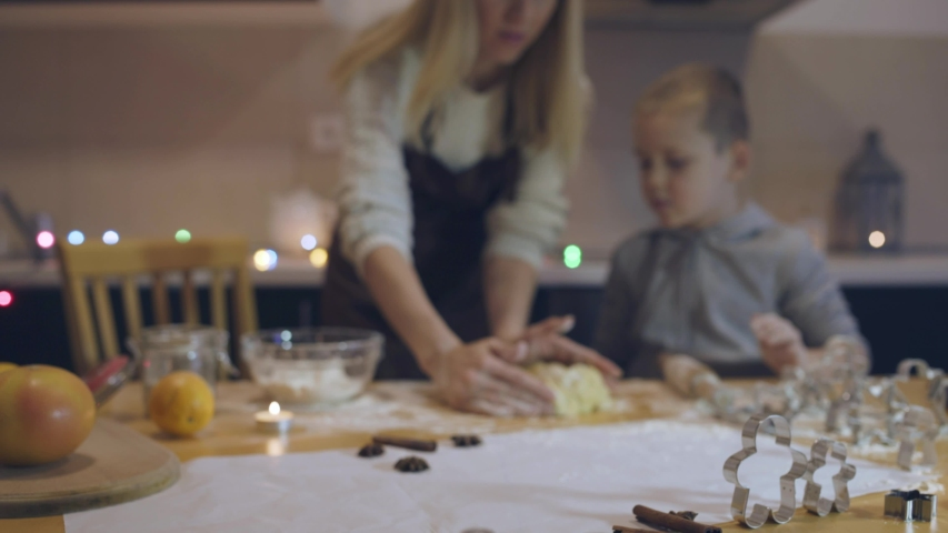 Mother and son baking Christmas cookies in the kitchen. Family life before the holidays at home. | Shutterstock HD Video #1045004134