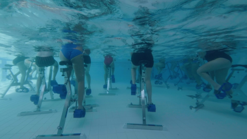 Behind view of women aqua biking in a swimming pool | Shutterstock HD Video #1045217614