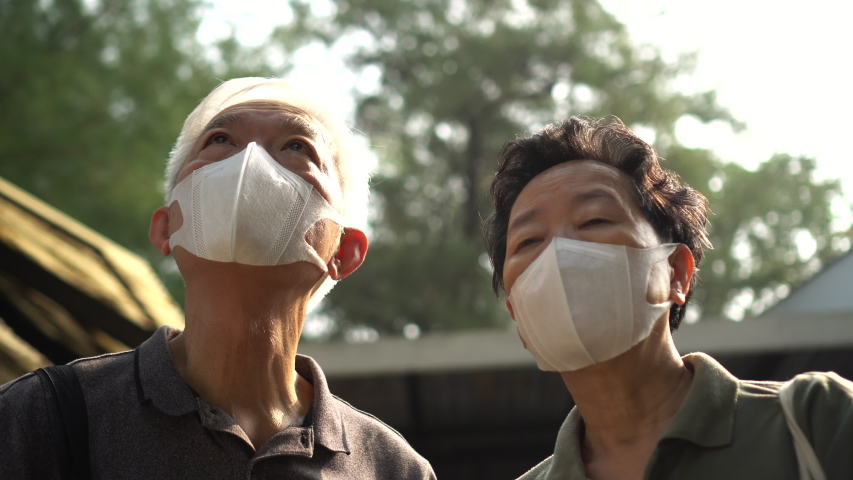 Hopeless Asian Chinese couple aware of 2019 ncv outbreak and smog situation wear preventing mask   Shutterstock HD Video #1045331554