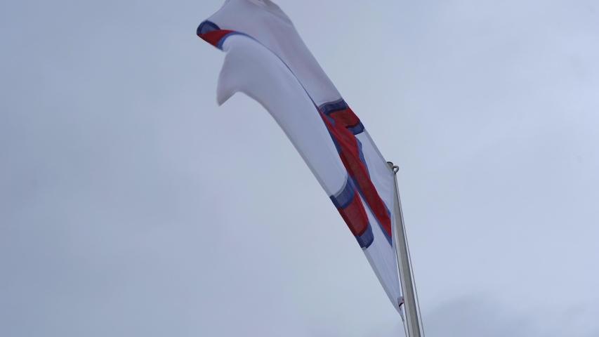 Flag of the Faroe Islands in a wind. | Shutterstock HD Video #1045431574
