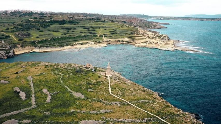 Malta. Saint Paul island hyperlapse. Malta hyperlapse. Island hyperlapse. Malta Saint Paul island aerial footage. Statue located on island. | Shutterstock HD Video #1045437934
