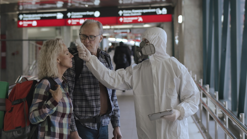 Temperature checkpoint at the entrance to departure area of airport. Protective measures in public places to prevent Covid-19 coronavirus spreading. Wuhan alert | Shutterstock HD Video #1045645654