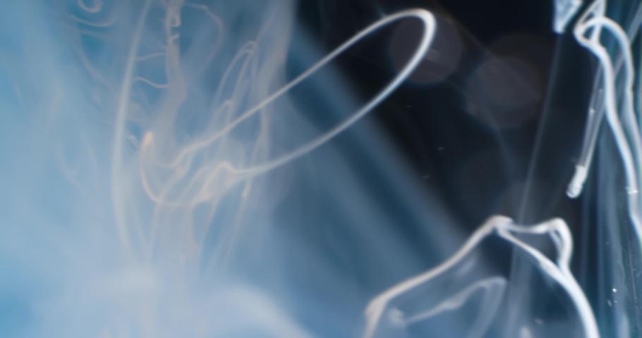 White  Fluid  in Motion underwater. Macro.  Liquids Threads. | Shutterstock HD Video #1046871244