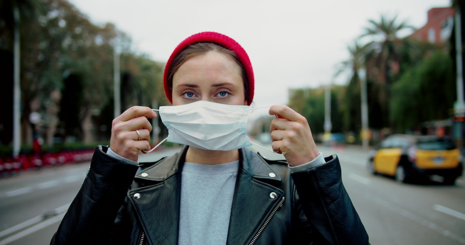 Portrait of a young student woman wearing protective mask on street.Concept of health and safety life, N1H1 coronavirus, virus protection, pandemic in china | Shutterstock HD Video #1046978314