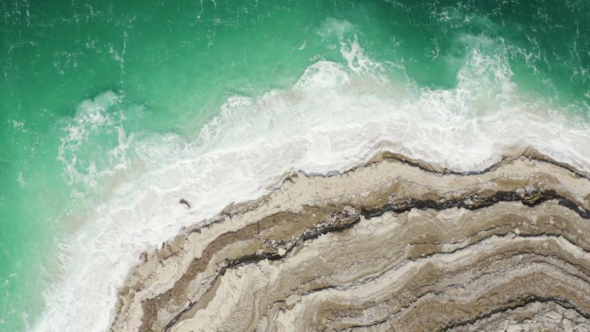 Aerial view of Dead Sea over the sea shore of Jordan,   Shutterstock HD Video #1047171784