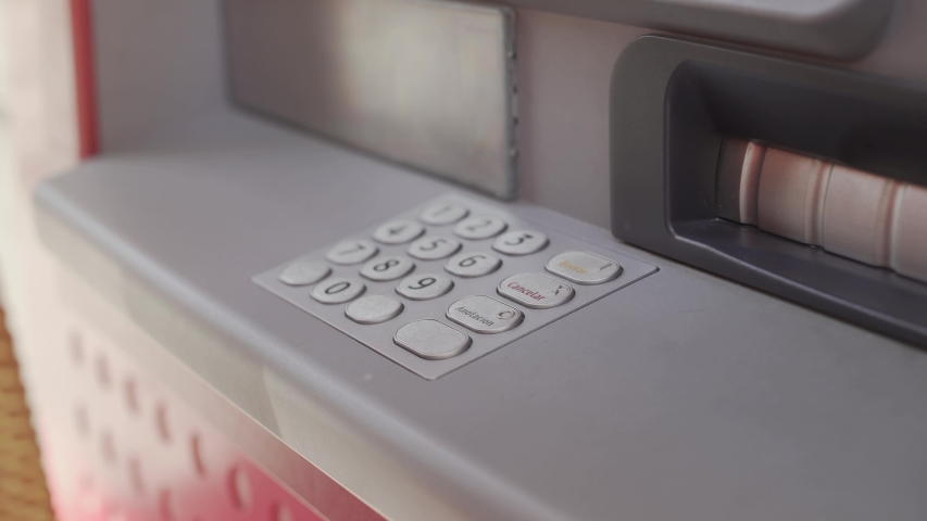 Woman's hand enters the code at the ATM. four digit code | Shutterstock HD Video #1047201544
