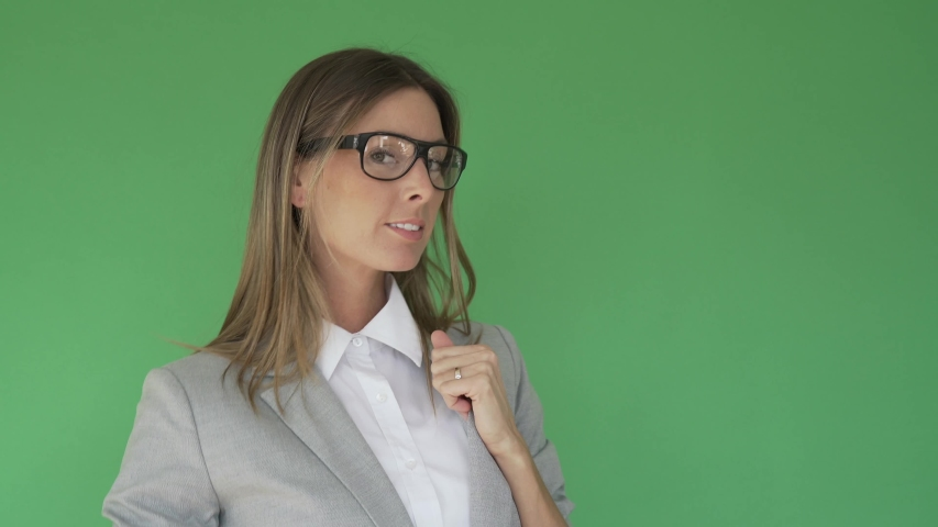 Businesswoman standing on green screen, isolated | Shutterstock HD Video #1047332674
