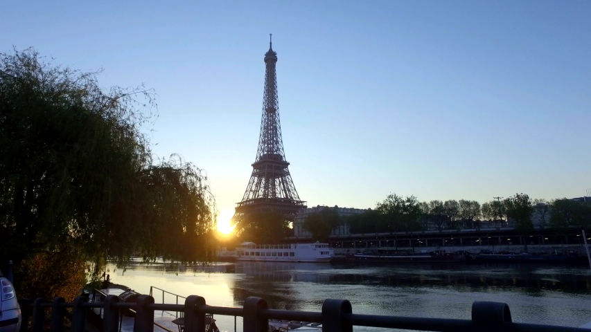 4K: The Eiffel Tower in Paris at Dawn or sunrise. The River Seine is in the foreground in the early morning. Stock Video Clip Footage | Shutterstock HD Video #1047380074