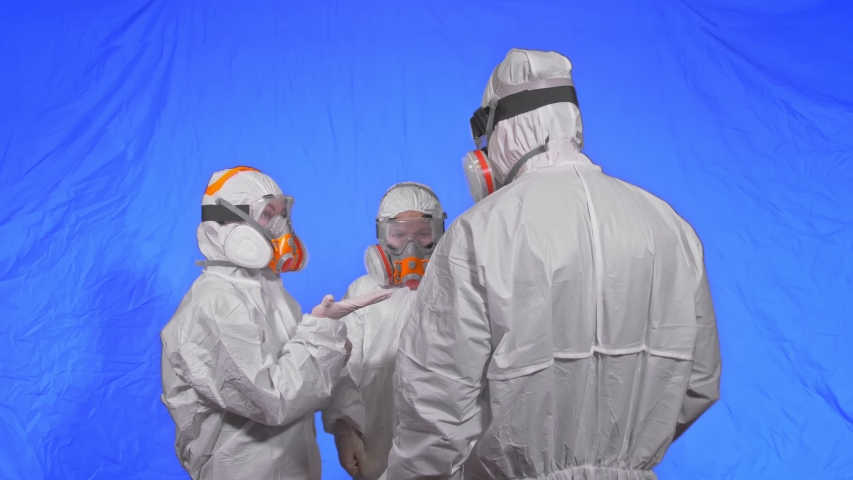 The family shield protect, to save life from virus. Slow motion. People portrait, wearing protect medical aerosol spray paint mask respirator. Concept health safety protection coronavirus epidemic. | Shutterstock HD Video #1049068534