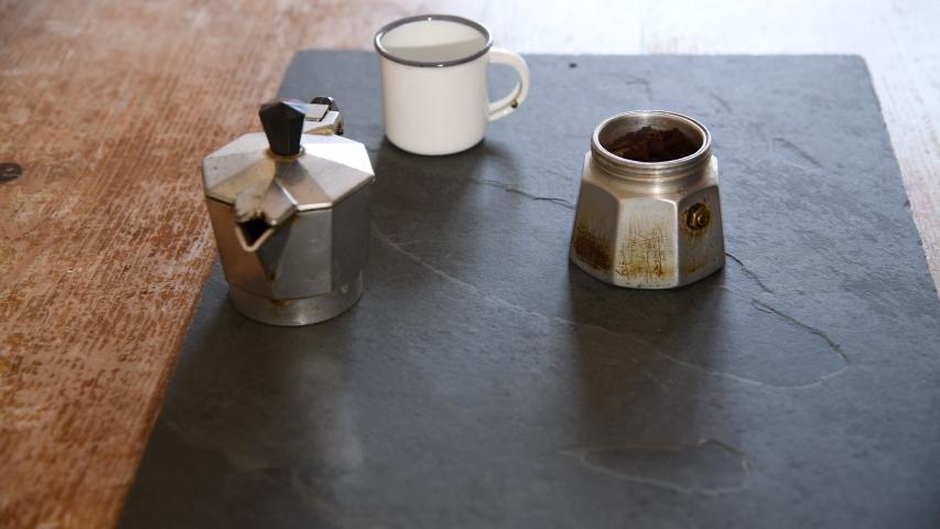 Making coffee with Moka pot. Italian espresso coffee in moka close-up.    Shutterstock HD Video #1049549644