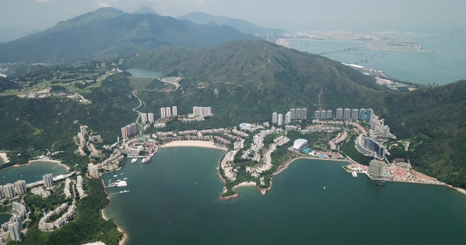 Aerial view of Discovery Bay on Lantau Island in Hong Kong | Shutterstock HD Video #1049561284