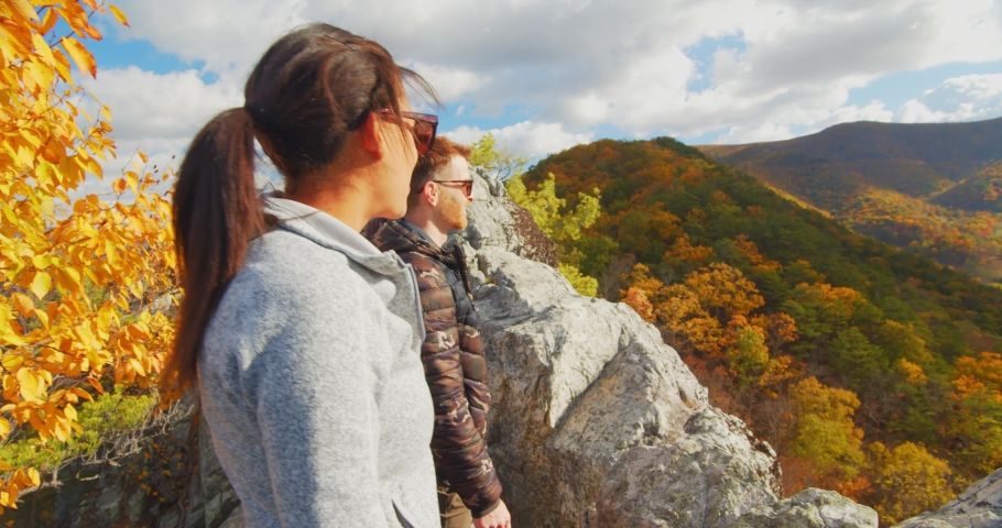 Two Hikers on Top of Seneca Rocks, West Virginia Landscape View | Shutterstock HD Video #1049616514
