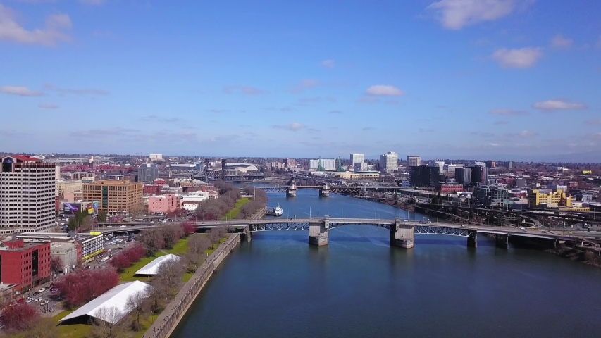 Aerial descending over the Willamette River in downtown Portland Oregon. | Shutterstock HD Video #1049623054