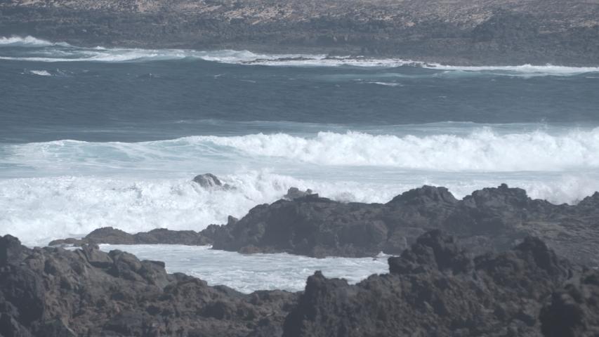 Powerful Waves breaking against a rocky coast, Fuerteventura, Canary Islands. | Shutterstock HD Video #1049632024