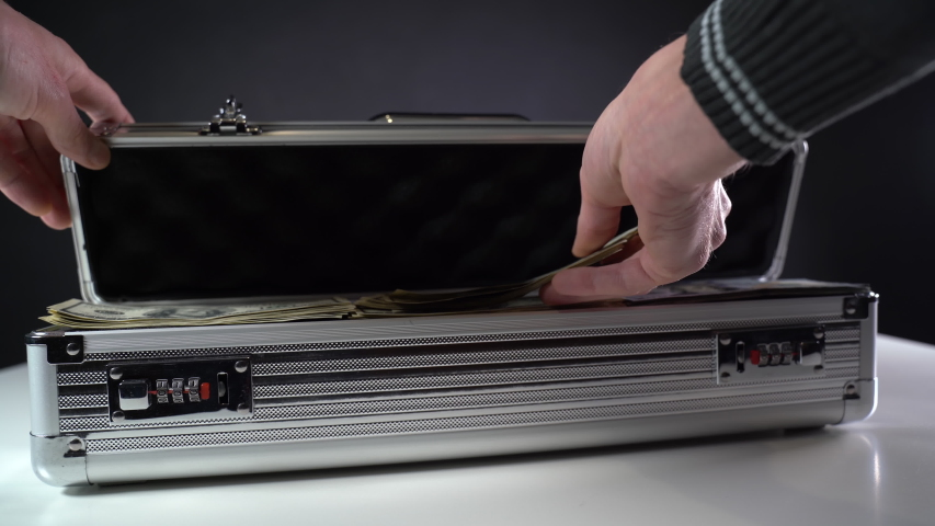 Open a metal suitcase with dollar bills. Close-up | Shutterstock HD Video #1049640814