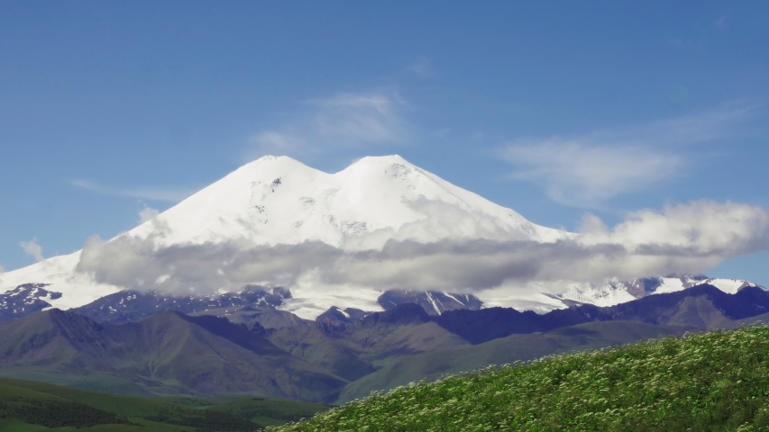 Mount Elbrus sunlight north side at summer sunny sunrise / mountain peak with snow cap, hat - Aerial drone close up open view | Shutterstock HD Video #1049647024