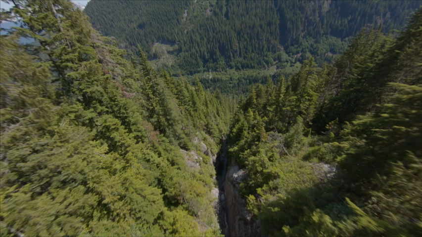 Aerial - Drone FPV Flying Through Vast Mountains with Cliffs and Canyons on Sunny Summer Day Squamish BC Canada 3 | Shutterstock HD Video #1049716444