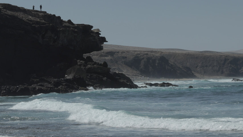 Waves crashing  on the rocky coastline of la pared, lanzarote | Shutterstock HD Video #1049813674