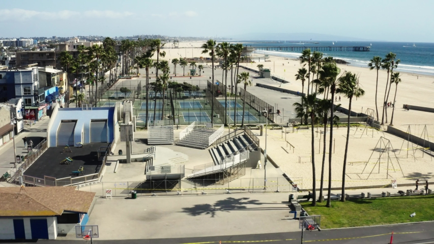 Quarantine in Los Angeles, aerial shot of Venice beach, deserted sports grounds, pandemic situation, empty city | Shutterstock HD Video #1049870944
