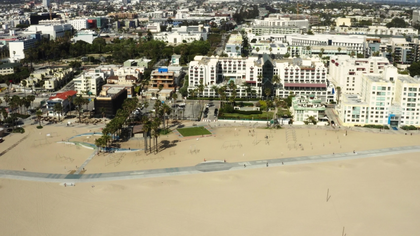 Quarantine in Los Angeles, aerial shot of Venice beach, deserted sports grounds, pandemic situation, empty city | Shutterstock HD Video #1049871004