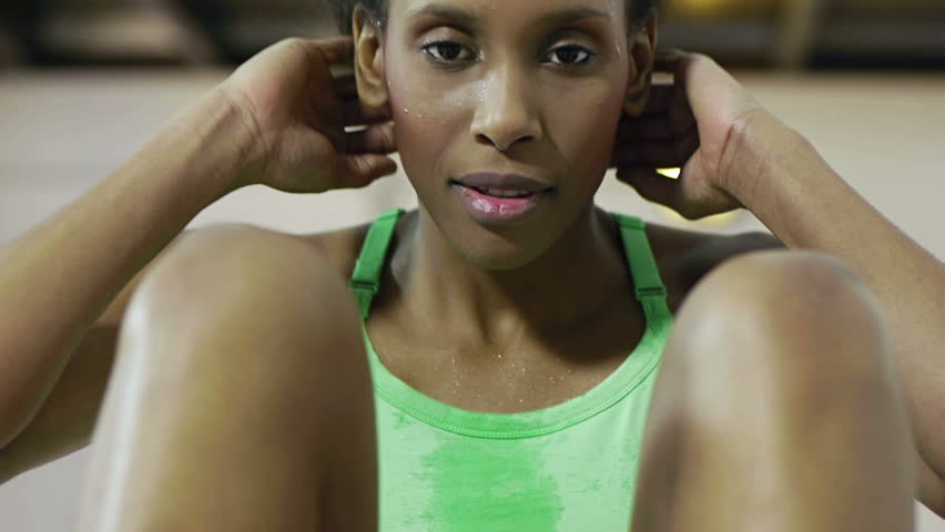 young african american woman in sportswear exercising abdominals in gym.