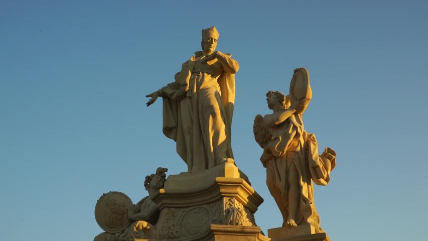 Charles bridge and statues of the saints in Prague. Saint Frantisek Borgias. Czech history and culture. | Shutterstock HD Video #1050036784