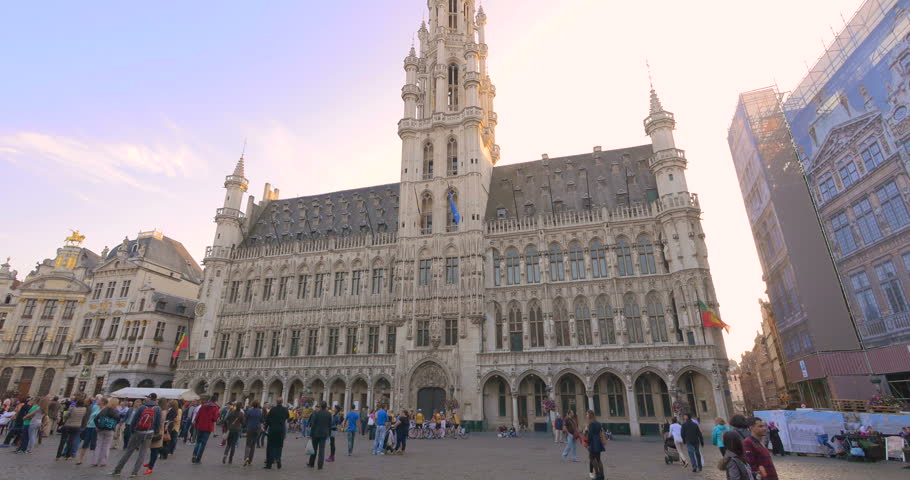 BRUSSELS BELGIUM EUROPE 14 SEP 2014: Pan tilt up motion video of town hall building architecture landmark, Bruxelles city main square, Grand place. Belgian and european famous capital