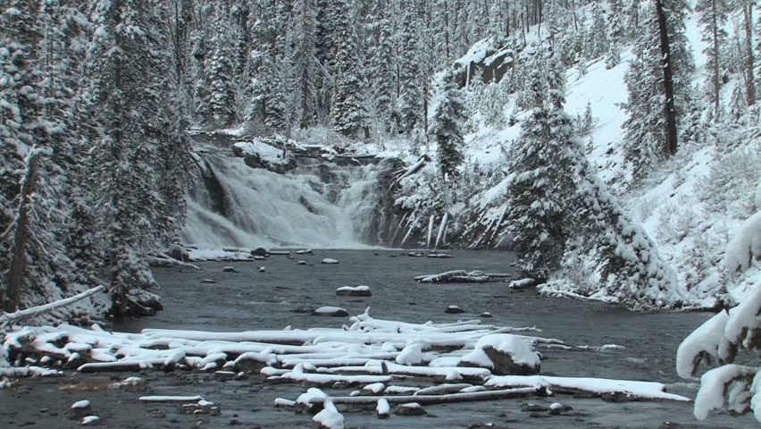Winter scene on waterfall in Southern Yellowstone