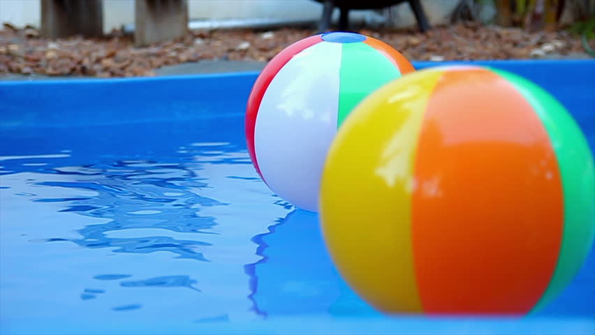 Pool Water With Beach Ball many colorful plastic toy balls floating in a children swimming