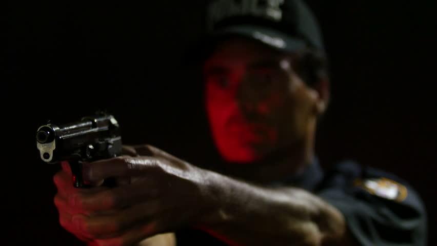 Police Officer firing a gun, close up of the gun | Shutterstock HD Video #10527704