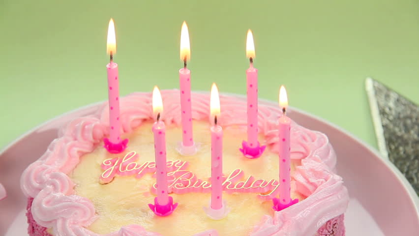 A beautiful cake with light candles to blow out wishing you a Happy Birthday.
