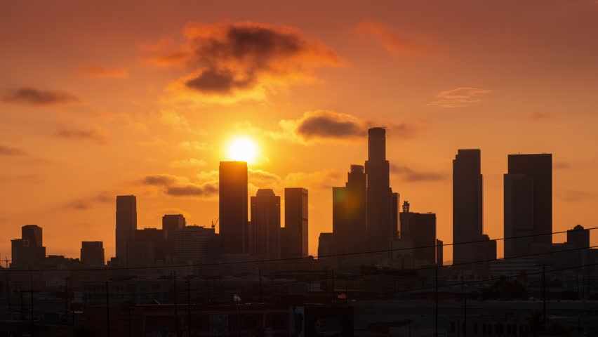 Beautiful sunset sun setting behind downtown Los Angeles city skyline. 4K UHD Timelapse. | Shutterstock HD Video #10557404