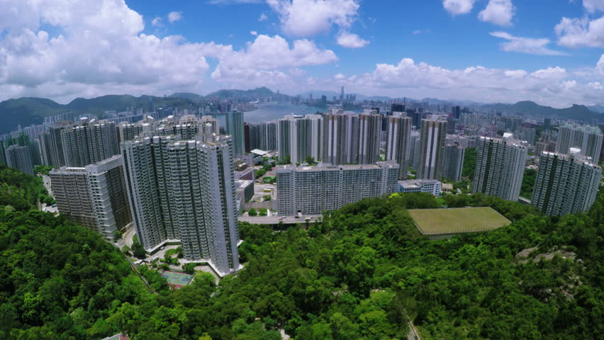 Beautiful Aerial Hong Kong 4K .  Stunning 4K aerial shot of Hong Kong of China. Residential district in Kowloon Peninsula in front of the Victoria Harbour and Hong Kong Island.  | Shutterstock HD Video #10561784