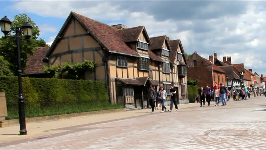 STRATFORD UPON AVON, UK - JUNE 8, 2015: Unidentified tourists and locals at main street of very touristic town where playwright and poet William Shakespeare was born. There is a house a birthplace