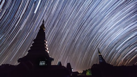 Star Trails Over King and Queen Pagoda Of Doi Inthanon Chiang Mai, Thailand (pan shot)