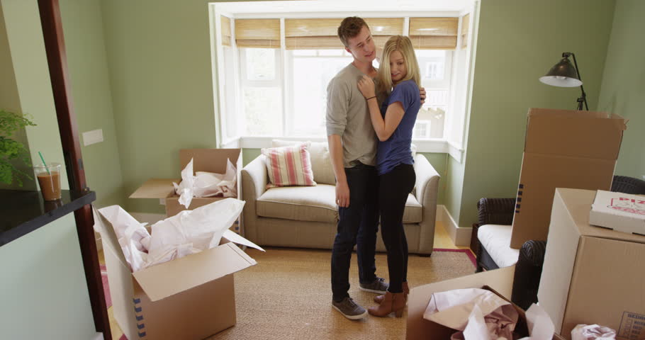 Happy young couple moving into their new apartment | Shutterstock HD Video #10594154