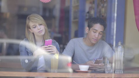 Young Couple Use Their Phones, Not Paying Attention To Each Other, Then They Talk (4K)