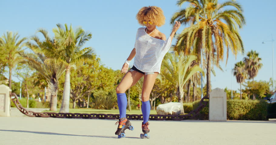 Beautiful And Sexy Girl Dancing on Roller Skates at Tropical Park in Slow Motion Video | Shutterstock HD Video #10608779