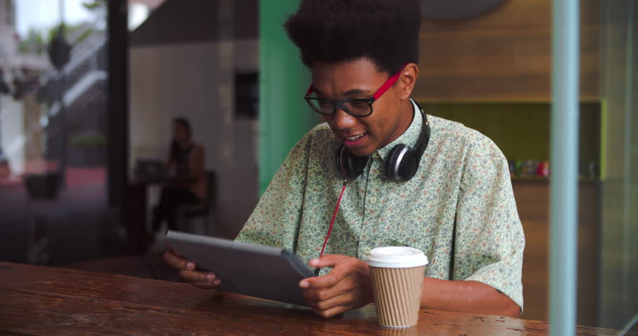 Young Businessman Working On Digital Tablet In Coffee Shop | Shutterstock HD Video #10611944