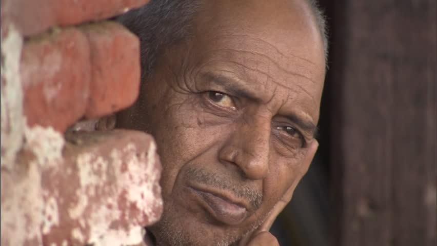 AGRA, INDIA – OCTOBER 23, 2010: Old indian man looking at the camera in Agra | Shutterstock HD Video #10626134