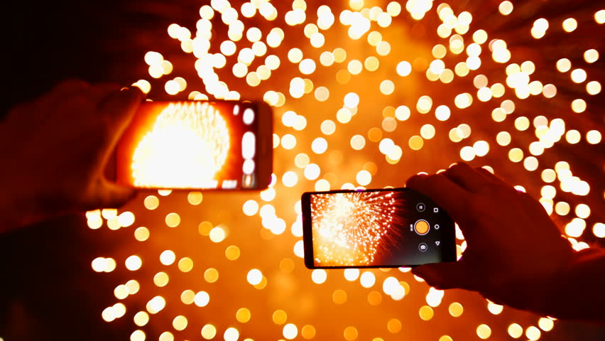 Man records video Fireworks on smart phone