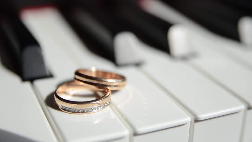 Wedding Rings On The Piano Hd Stock Video Clip