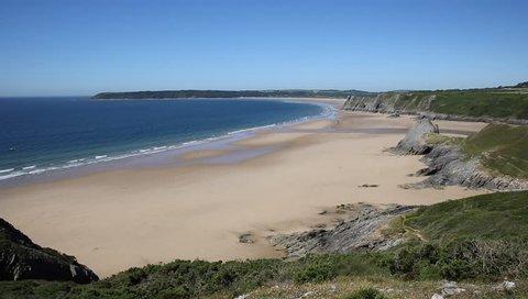 The Gower Peninsula coast Three Cliffs Bay near Swansea Wales uk popular tourist destination