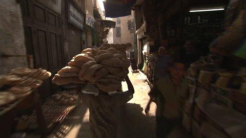 Cairo, Egypt. JUNE 26, 2010: Children selling bread in Cairo, Egypt