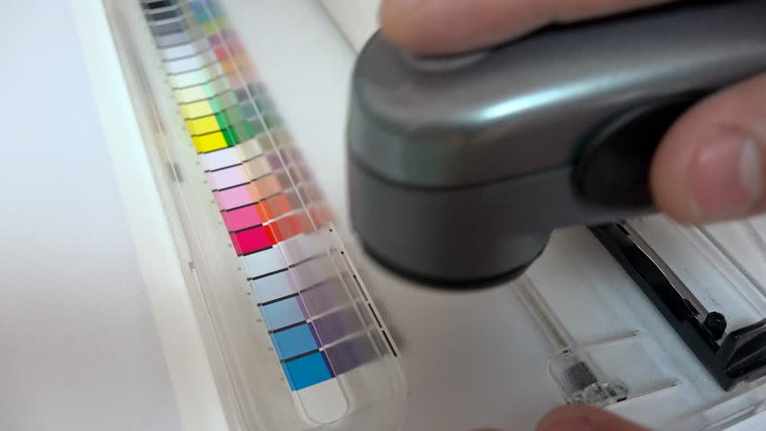 4K Print Spectrophotometer on Chart color control measurement. UHD stock footage