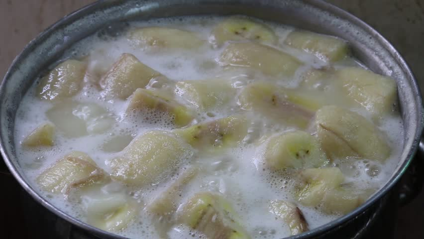 Cooking tiger prawns in boiling water in saucepan speed up thai sweet banana in coconut milk hd stock video clip forumfinder Image collections
