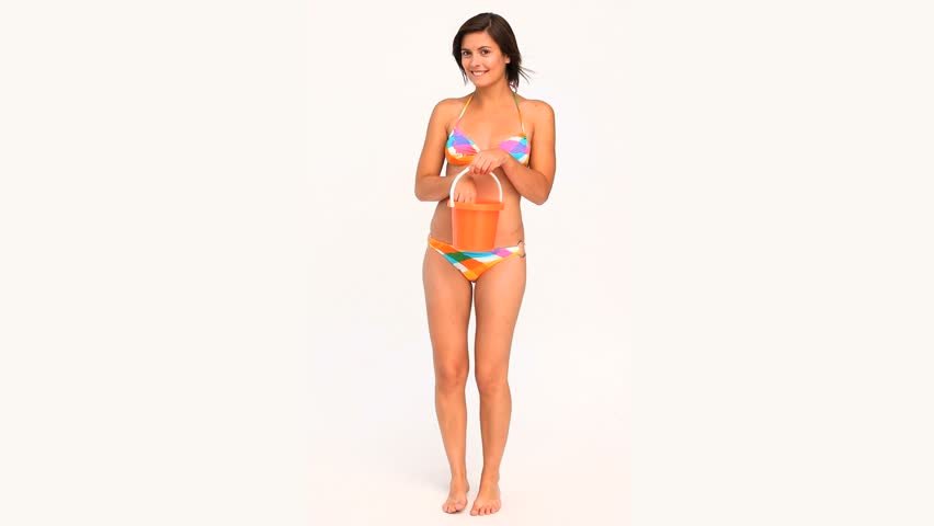 be2728ab027 Brunette woman in swimsuit going to the beach isolated on a white background