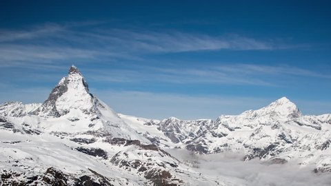 4k timelapse of the amazing matterhorn and surrounding mountains in the Swiss Alps with fantastic cloud formations