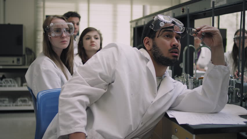 Students in a science lab listen to their professor and raise their hands | Shutterstock HD Video #10723619